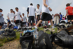 Men and boys gather their shoes after prayer on large blue tarps on the football field at two o'clock when the call to prayer comes over a loud speaker in South Brunswick, New Jersey on May 26, 2007.  Over 600 youths from five states participated in the event.