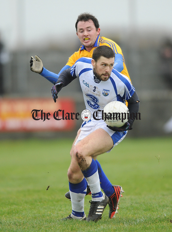 Stephan Prendergast of Waterford in action against David Tubridy of Clare in action during their national league game at Miltown Malbay. Photograph by John Kelly.
