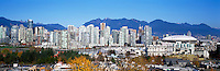 "City of Vancouver Skyline and Downtown at Yaletown and ""False Creek"", BC, British Columbia, Canada, in Autumn / Fall.  The North Shore Mountains (Coast Mountains) rise above the City. - Panoramic View (Historical Roof on BC Place)"