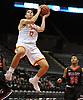Michael O'Connell #12 of Chaminade makes an acrobatic move to get off a shot during a non-league varsity boys basketball game against Half Hollow Hills East at Nassau Coliseum in Uniondale on Sunday, Jan. 21, 2018. Hills East won by a score of 90-68.