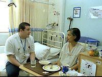 A nurse tends to his patient on a hospital ward. Date: 31.10.2005. <br />