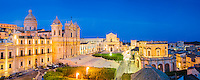 Panoramic photo of Noto at night, St Nicholas Cathedral (Noto Cathedral), Church of San Salvatore (Basilica San Salvatore) and Town Hall (Municipio) in Piazza del Municipio, Noto, Sicily, Italy, Europe. This is a panoramic photo of Noto at night, showing St Nicholas Cathedral (Noto Cathedral), Church of San Salvatore (Basilica San Salvatore) and Town Hall (Municipio) in Piazza del Municipio, Noto, Sicily, Italy, Europe.