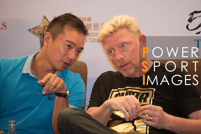 (L-R) Tenniel Chu, Boris Becker during the Sports Legends Press Conference on the sidelines of the World Celebrity Pro-Am 2016 Mission Hills China Golf Tournament on 22 October 2016, in Haikou, China. Photo by Weixiang Lim / Power Sport Images