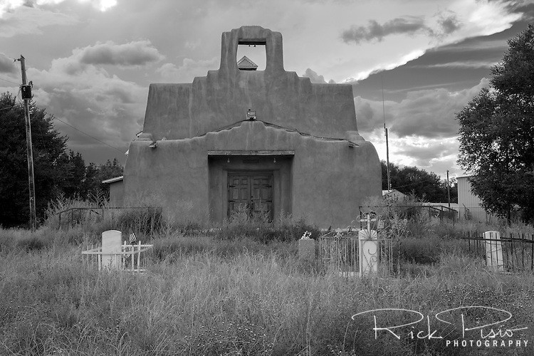 The San Jose de Chama Church in Hernandez, New Mexico. On November 1, 1941 Ansel Adams photographed this same church and surrounding area from a different angle in a photo that became known as Moonrise Hernandez