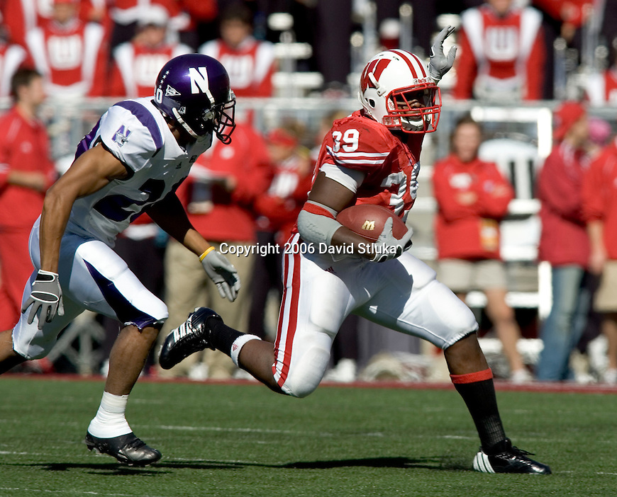 MADISON, WI - OCTOBER 7: Running back P.J. Hill #39 of the Wisconsin Badgers carries the ball against the Northwestern Wildcats at Camp Randall Stadium on October 7, 2006 in Madison, Wisconsin. The Badgers beat the Wildcats 41-9. (Photo by David Stluka)
