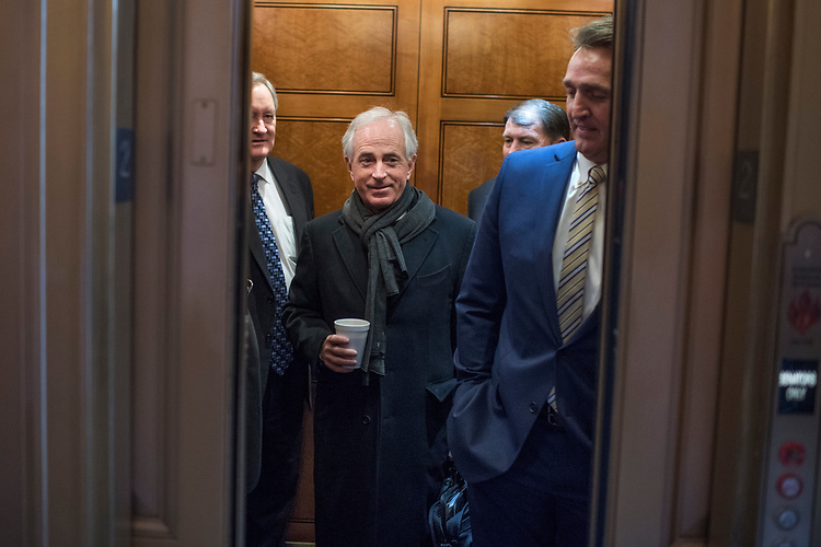 UNITED STATES - MARCH 15: From left, Sens. Bob Corker, R-Tenn., Mike Crapo, R-Idaho, Mike Rounds, R-S.D., and Jeff Flake, R-Ariz.,  board an elevator in the Capitol after a vote, March 15, 2017. (Photo By Tom Williams/CQ Roll Call)