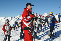 Switzerland. Valais. Crans Montana. Winter ski resort. Swiss Ski School teacher meet his students skiers before the start of the class. Blue sky on a sunny day. © 2005 Didier Ruef