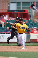 Erie SeaWolves third baseman Isaac Paredes (18) throws to first base in front of umpire Tom West signaling fair ball during an Eastern League game against the Altoona Curve and on June 4, 2019 at UPMC Park in Erie, Pennsylvania.  Altoona defeated Erie 3-0.  (Mike Janes/Four Seam Images)