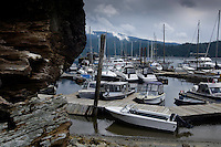 Boats moored at jetty. Deep Cove,Vancouver, British Columbia, Canada.