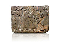 Hittite monumental relief sculpted orthostat stone panel of Procession. Basalt, Karkamıs, (Kargamıs), Carchemish (Karkemish), 900 - 700 B.C. Goddess Kubaba. Anatolian Civilisations Museum, Ankara, Turkey.<br /> <br /> Procession for. There are four figures on the other face of the orthostat. The leftmost figure plays a pipe, while the other three figures play the drums. All of the figures have long skirts and same body heights.  <br /> <br /> Against a white background.