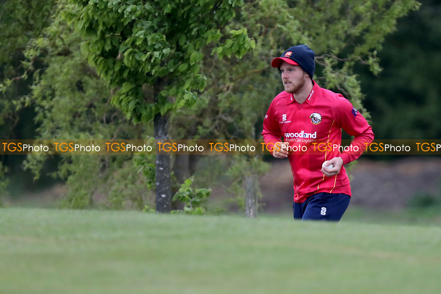 Jamie Porter retrieves the ball from down a slope during Essex CCC 2nd XI vs Surrey CCC 2nd XI, Second XI Trophy Cricket at Billericay Cricket Club on 3rd May 2017