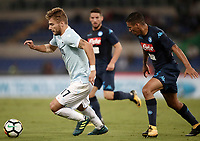 Calcio, Serie A: Roma, stadio Olimpico, 20 settembre 2017.<br /> Lazio's Ciro Immobile (l) in action with Napoli's Allan Marquez Loureiro (r) during the Italian Serie A football match between Lazio and Napoli at Rome's Olympic stadium, September 20, 2017.<br /> UPDATE IMAGES PRESS/Isabella Bonotto