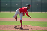 Cincinnati Reds starting pitcher Hunter Greene (21) follows through on his delivery during a Minor League Spring Training game against the Los Angeles Angels at the Cincinnati Reds Training Complex on March 15, 2018 in Goodyear, Arizona. (Zachary Lucy/Four Seam Images)