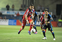 Chicago Fire defender Gonzalo Segares (13) plays the ball in the air as Philadelphia Union midfielder Roger Torres (8) looks on.  The Chicago Fire defeated the Philadelphia Union 1-0 at Toyota Park in Bridgeview, IL on March 24, 2012.