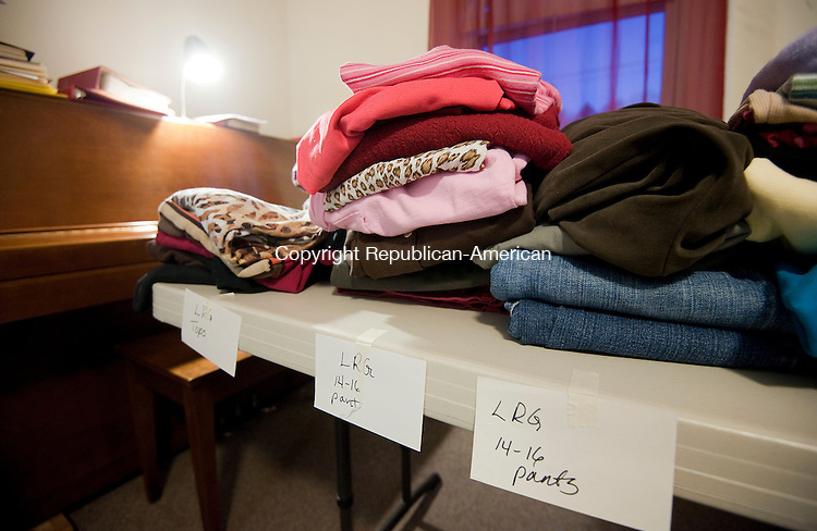 PLYMOUTH, CT--- -112015JS03--Clothing of all sizes were on display during the Clothes Closet Giveaway Friday at the First Baptist Church in Plymouth. The event  continues today from 10am to 4pm. All are welcome to pick out sizes and styles and take whatever clothing is appropriate for their needs. <br /> Jim Shannon Republican-American