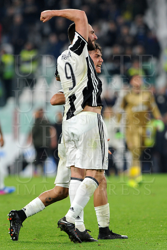 Calcio, Serie A: Juventus vs Milan. Torino, Juventus Stadium, 10 marzo 2017.<br /> Juventus' Paulo Dybala, right, celebrates with his teammate Gonzalo Higuain after scoring on a penalty kick the winning goal during the Italian Serie A football match between Juventus and AC Milan at Turin's Juventus Stadium, 10 March 2017. Juventus won 2-1.<br /> UPDATE IMAGES PRESS/Manuela Viganti
