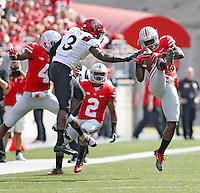Ohio State Buckeyes cornerback Doran Grant (12) makes an interception in front of San Diego State Aztecs wide receiver Ezell Ruffin (3) during the 1st quarter of their college football game at Ohio Stadium in Columbus on September 7, 2013.  (Dispatch photo by Kyle Robertson)