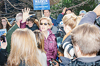 Democratic presidential candidate and Massachusetts senator Elizabeth Warren and husband Bruce Mann greet supporters gathered along Linnaean Street as she walked to Graham & Parks School to vote in the Massachusetts primary as part of Super Tuesday voting in Cambridge, Massachusetts, on Tue., March 3, 2020. The polling place is just a few blocks from Warren's residence. Polls show Warren and Vermont senator Bernie Sanders in a near tie in the Massachusetts Democratic party primary.