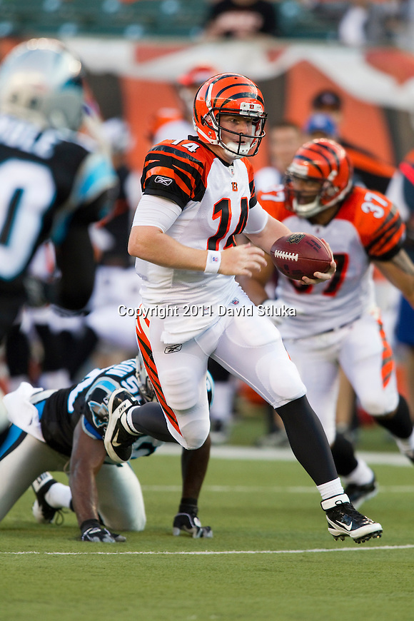 Cincinnati Bengals quarterback Andy Dalton (14) scrambles for yardage during an NFL preseason football game against the Carolina Panthers on August 25, 2011 in Cincinnati, Ohio. The Bengals won 24-13. (AP Photo/David Stluka)