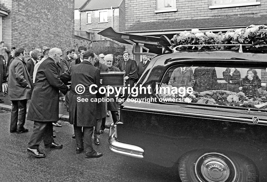 Funeral of 17 months old Colin Nicholl, the adopted son of Anne and &amp; Jackie Nicholl of Elimgrove Street, Belfast, N Ireland, UK. Colin was one of two children who died in a no warning Provisional IRA attack at a Shankill Road furniture store. The other child was 2 year old Tracey Munn, Alloa Street, Belfast. The two funerals joined up in Clifton Park Avenue on the way to the cemetery. 197112140533a<br />