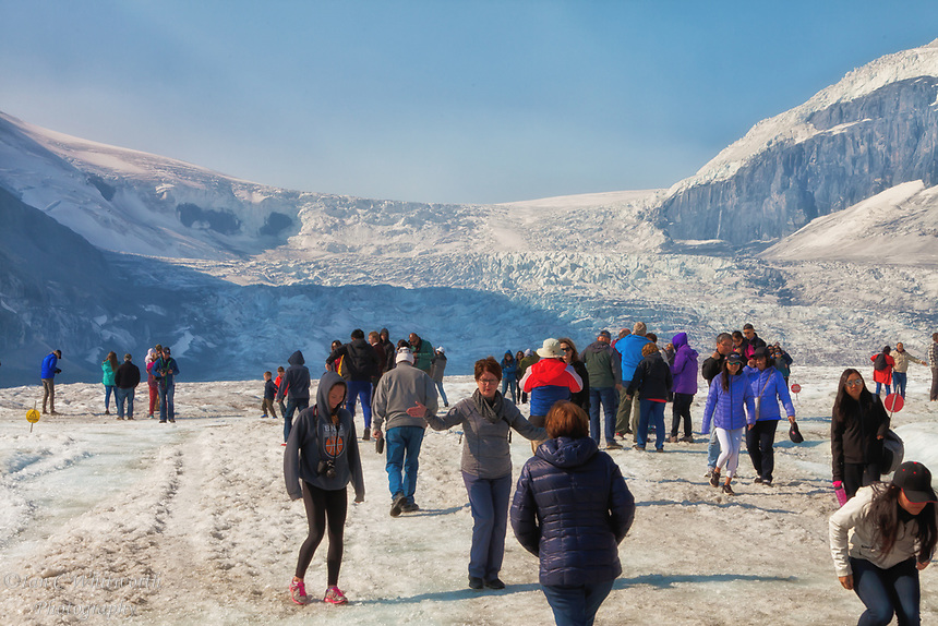 Tourists walking on the Athabasca Glacier in Jasper National Park in August.