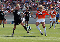 BOYDS, MARYLAND - July 22, 2012:  Joanna Lohman (17) of DC United Women goes for the ball against Kelsey Fenix (10) of the Charlotte Lady Eagles during the W League Eastern Conference Championship match at Maryland Soccerplex, in Boyds, Maryland on July 22. DC United Women won 3-0.