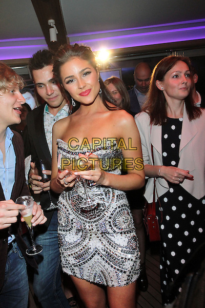 Olivia Culpo<br /> Olivia Culpo at the opening of restaurant &quot;the Rose Bar&quot;, Moscow, Russia.<br /> May 29th, 2013<br /> half length white silver beads beaded dress strapless embellished jewel encrusted cocktail alcohol drink beverage<br /> CAP/PER/LS<br /> &copy;LS/PersonaStars/CapitalPictures