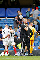 Sheffield United manager, Chris Wilder beats his chest for the fans during the Premier League match between Chelsea and Sheff United at Stamford Bridge, London, England on 31 August 2019. Photo by Carlton Myrie / PRiME Media Images.