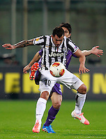 Calcio, ritorno degli ottavi di finale di Europa League: Fiorentina vs Juventus. Firenze, stadio Artemio Franchi, 20 marzo 2014. <br /> Juventus forward Carlos Tevez, of Argentina,  , foreground, is challenged by Fiorentina defender Facundo Roncaglia, of Argentina, during the Europa League round of 16 second leg football match between Fiorentina and Juventus at Florence's Artemio Franchi stadium, 20 March 2014. Juventus won 1-0 to advance to the quarter-finals.<br /> UPDATE IMAGES PRESS/Isabella Bonotto