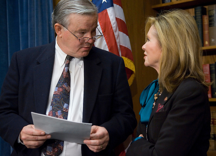 WASHINGTON, DC - Dec. 06: House Energy ranking member Joe L. Barton, R-Texas, and Rep. Marsha Blackburn, R-Tenn., before a news conference on the energy bill. The House brushed aside a new White House veto threat against comprehensive energy legislation, passing the bill Thursday and sending it to an uncertain fate in the Senate. The White House renewed a threat to veto the bill over tax provisions and a renewable electricity mandate. The measure (HR 6) would boost corporate average fuel economy standards, require billions of gallons of ethanol and other biofuels to be blended into gasoline, and mandate that 15 percent of electricity by 2020 come from renewable sources. (Photo by Scott J. Ferrell/Congressional Quarterly).