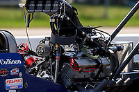 Aug 16, 2014; Brainerd, MN, USA; Detailed view of a blower belt wrapped around the engine of NHRA top fuel dragster driver Tim Cullinan during qualifying for the Lucas Oil Nationals at Brainerd International Raceway. Mandatory Credit: Mark J. Rebilas-