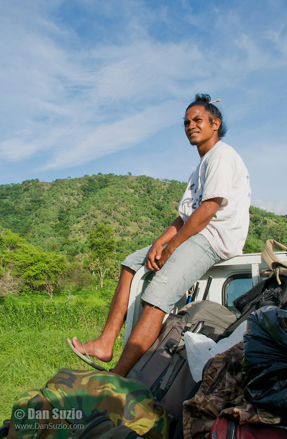 Laca Ribeiro rides on top of a truck, Atauro Island, Timor-Leste (East Timor)