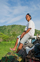 Laca Ribeiro rides on top of a truck, Atauro Island, Timor-Leste (East Timor)