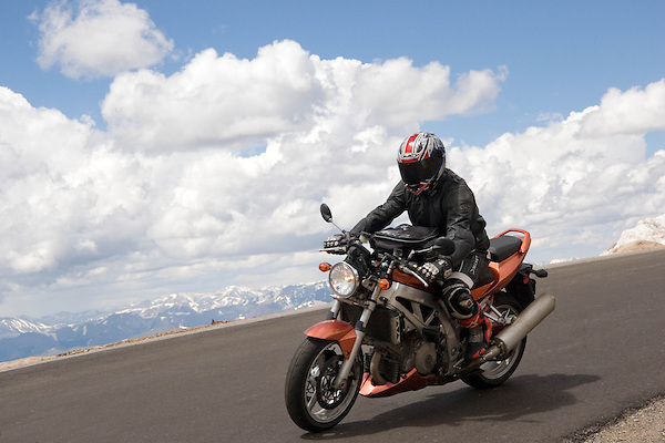 Motorcyclist on Mt Evans Road near Idaho Springs, Colorado. Wildlife  photo tours to Mt Evans. .  John offers private photo tours in Denver, Boulder and throughout Colorado. Year-round.