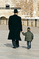 A father and son walk in the Western Wall Plaza in Jerusalem. Beginning in the 16th century, the Western Wall of the destroyed Temple became a Jewish place of pilgrimage located in a narrow alley just 12 feet wide. Immediately after the Six Day War in 1967, Israelis leveled the neighboring Arab neighborhood and created a large open area known as the Western Wall Plaza.