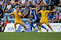 Gillingham's Alfie Jones (centre) under pressure from Bolton Wanderers' James Weir (left) & Bolton Wanderers' Dennis Politic (right) <br /> <br /> Photographer David Horton/CameraSport<br /> <br /> The EFL Sky Bet League One - Gillingham v Bolton Wanderers - Saturday 31st August 2019 - Priestfield Stadium - Gillingham<br /> <br /> World Copyright © 2019 CameraSport. All rights reserved. 43 Linden Ave. Countesthorpe. Leicester. England. LE8 5PG - Tel: +44 (0) 116 277 4147 - admin@camerasport.com - www.camerasport.com
