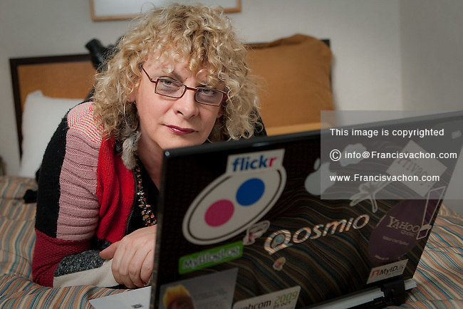 Michelle Blanc poses with her laptop in her hotel room in Quebec city November 10, 2009. Born as a male, Michel was a suicidal mental health patient who discovered his gender identity disorder. With the help of the Internet to get support, she his now Michelle, a female successful Internet entrepreneur.