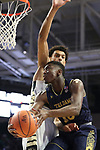 WINSTON-SALEM, NC - FEBRUARY 24: Notre Dame's Temple TJ Gibbs (10) and Wake Forest's Olivier Sarr (FRA) (behind). The Wake Forest University Demon Deacons hosted the University of Notre Dame Fighting Irish on February 24, 2018 at Lawrence Joel Veterans Memorial Coliseum in Winston-Salem, NC in a Division I men's college basketball game. Notre Dame won the game 76-71.