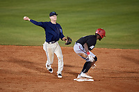 Mobile BayBears shortstop Hutton Moyer (11) throws to first base as Nick Gordon (1) ducks while standing on second base during a game against the Chattanooga Lookouts on May 5, 2018 at Hank Aaron Stadium in Mobile, Alabama.  Chattanooga defeated Mobile 11-5.  (Mike Janes/Four Seam Images)