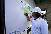 Anthony Kim (USA) signs the world map after finishing his round during Sunday's Final Round of the rain shortened 2011 Barclays Singapore Open, Singapore, 13th November 2011 (Photo Eoin Clarke/www.golffile.ie)