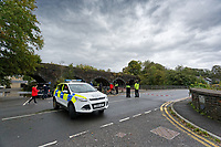 Pictured: Police on Dulais Fach Road (B4434) between the areas of Aberdulais and Tonna in Neath, south Wales, UK. Saturday 13 October 2018<br /> Re: Flooding caused by Storm Callum in the Neath area, south Wales, UK.