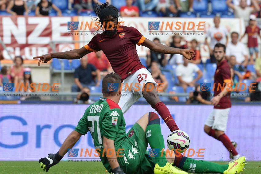 Gervinho Roma, Alessio Cragno Cagliari.<br /> Roma 21-09-2014 Stadio Olimpico. Football Calcio 2014/2015 Serie A. AS Roma - Cagliari. Foto Antonietta Baldassarre / Insidefoto