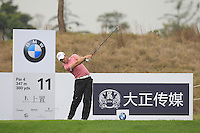 Danny Willett (ENG) tees off the 11th tee during Friday's Round 2 of the 2014 BMW Masters held at Lake Malaren, Shanghai, China 31st October 2014.<br /> Picture: Eoin Clarke www.golffile.ie