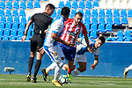 CD Leganes' Mauro Dos Santos (l) and Unai Bustinza (r), Atletico de Madrid's Keidi Bare (c) and the referee Carlos Del Cerro Grande during friendly match. August 12,2017. (ALTERPHOTOS/Acero)