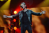 SUNRISE, FL - DECEMBER 21: Nick Jonas performs during the Y100's Jingle Ball 2014 at BB&T Center on December 21, 2014 in Miami, Florida. Credit Larry Marano (C) 2014