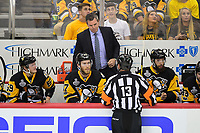May 31, 2017: Pittsburgh Penguins head coach Mike Sullivan questions a call with referee Dan O'Halloran (13) during game two of the National Hockey League Stanley Cup Finals between the Nashville Predators  and the Pittsburgh Penguins, held at PPG Paints Arena, in Pittsburgh, PA. The Penguins defeat the Predators 4-1 and lead the series 2-0. Eric Canha/CSM