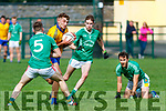 Damien Somers Feale Rangers bursting thru Sean Horan St Kierans watched by Philip O'Connor during the Garveys Supervalu County Championship game played in Listowel on Sunday