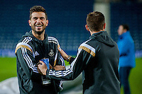 WEST BROMWICH, ENGLAND - FEBRUARY 11:  Jordi Amat and Angel Rangel of Swansea City  share a joke on the pitch prior to the Premier League match between West Bromwich Albion and Swansea City at The Hawthorns on February 11, 2015 in West Bromwich, England. (Photo by Athena Pictures/Getty Images)