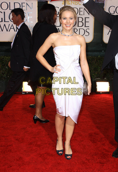 KRISTEN BELL.67th Golden Globe Awards held Beverly Hilton, Beverly Hills, California, USA..January 17th, 2010.globes full length white dress strapless black hand on hip clutch bag open toe.CAP/ADM/KB.©Kevan Brooks/Admedia/Capital Pictures
