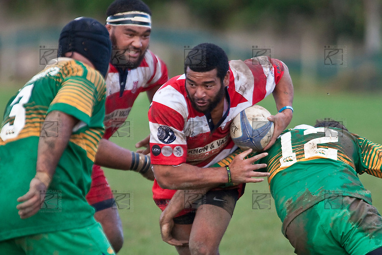 With Uini Antonio on his shoulder Siale Piutau heads infield. Counties Manukau Club rugby Premier game between Drury and Karaka played at Drury on Saturday May 1st, 2010. Karaka won the game 32 -12 after leading 25 - 7.